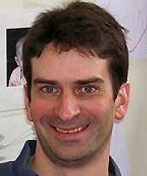 Том Карновски